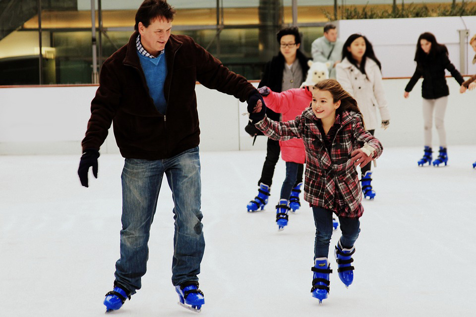 Family skating at Manchester City's Christmas Ice Rink